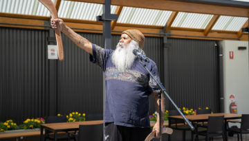 Ngarrindjeri and Kaurna Elder, Major Sumner AM, offers a Welcome to Country in the courtyard of the refurbished Hutt St Centre.